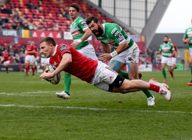 Munster's Andrew Conway runs in for his second try of the game.
