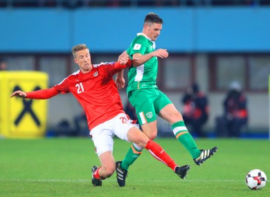 Austria's Marc Janko (left) and Republic of Ireland's Ciaran Clark battle for the ball.