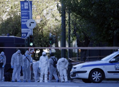 Police search for evidence after an explosion outside the French Embassy in Athens.
