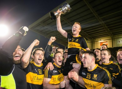 Johnny Buckley and Dr Crokes players celebrate with the cup.