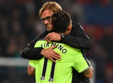 Liverpool manager Jurgen Klopp with Roberto Firmino.