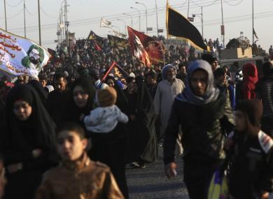Shiite pilgrims make their way to Karbala for Arbaeen on Wednesday.