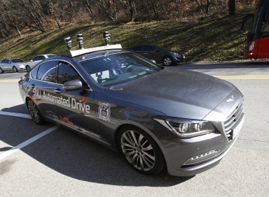 The driverless car called Snuber is test driven during a demonstration at the Seoul National University's campus in Seoul.