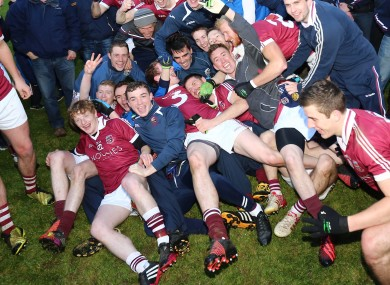 Slaughtneil's players celebrate their Derry final win against Loup last month.