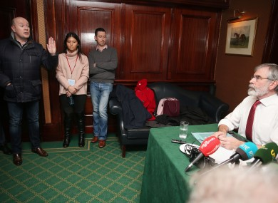Austin Stack (left), son of Brian Stack, a prison officer murdered in 1983, confronts Sinn Fein leader Gerry Adams (right) during a Sinn Fein press conference at the Davenport Hotel in Dublin.