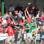 Loughgiel's Damon McMullan rises above Ballygalget players.<span class=