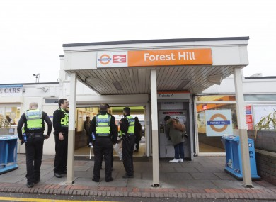 Police officers at Forest Hill train station after the incident.