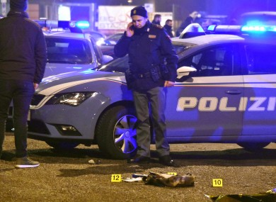 Police at the scene in Milan where the suspect was shot dead.