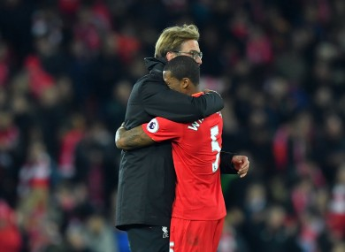 Klopp embraces with his young player at full time.