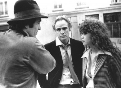 Director Bernardo Bertolucci, left, discusses a scene from