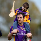 Ryan O'Dwyer has his son Oisin for company after the defeat to Kilmacud Crokes.<span class=
