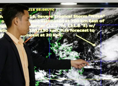 Weather specialist Benison Estareja shows the track of Tropical Storm Nock-Ten during a press conference in Quezon city, north of Manila, yesterday.