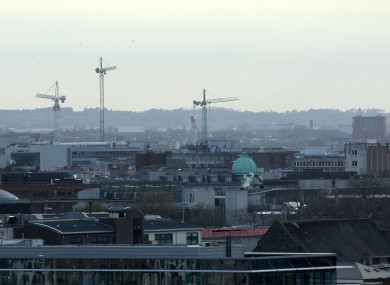 Construction cranes in the sky in Dublin city
