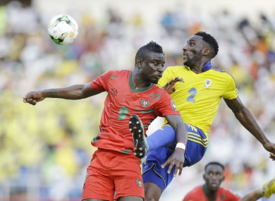 Gabon's Pierre Aaron Appindangoye, right, is challenged by Guinea Bissau's Abel Camara.