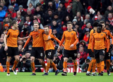 Wolves players celebrate at Anfield yesterday.