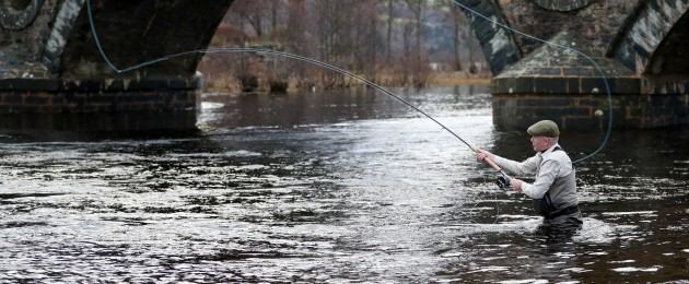 Angler Alan Wilson, from Glasgow, on the River Tay in Kenmore, near Perth, Scotland on the opening day of the salmon fishing season.