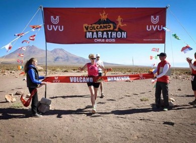 Kane crossing the finish line at the Volcano Marathon in 2015.