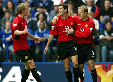 Darren Fletcher, Roy Keane and Phil Neville celebrating a Manchester United goal against Leicester City in 2003.