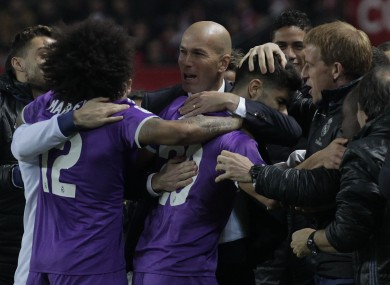 Real Madrid's coach Zidane, celebrates with Real Madrid's players after Marco Asensio scored during a Spain's King's Cup soccer match.