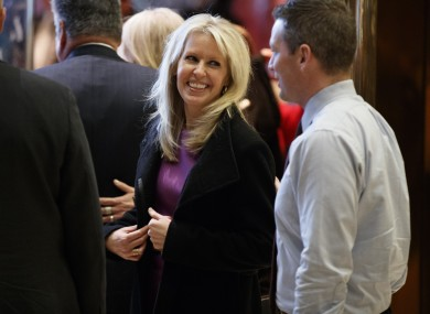 Monica Crowley smiles as she exits the elevator in the lobby of Trump Tower in New York in December.