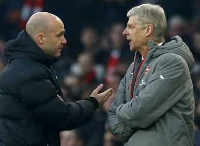 Arsenal manager Arsene Wenger is involved in an exchange with fourth official Anthony Taylor during their game with Burnley