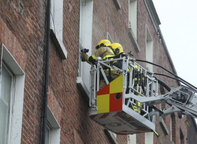 Members of Dublin Fire Brigade at the scene in MountJoy Square on Tuesday.