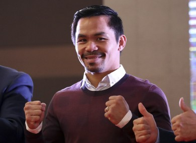 Filipino boxer Manny Pacquiao poses for fans.