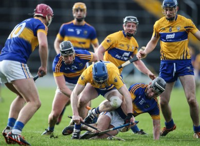 Tipperary and Clare players battle for possession in Thurles.