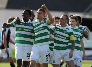 The Celtic players celebrate Jozo Simunovic's opener.