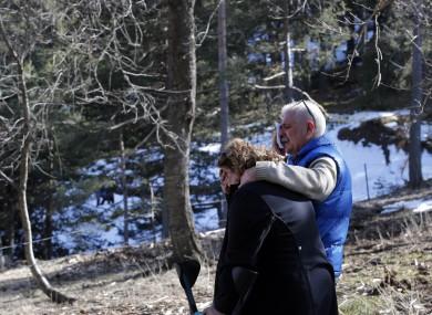 Family members look on at the Germanwings plane crash site.