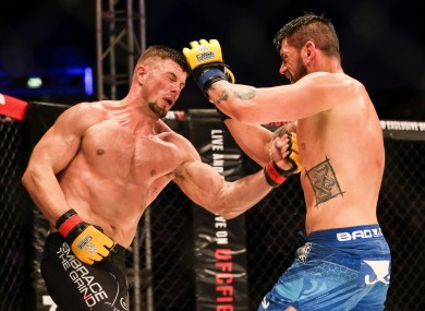 Action from Saturday's Cage Warriors 81 main event, in which Belfast's Karl Moore (left) defeated American opponent Josh Clark to win the vacant light-heavyweight title.