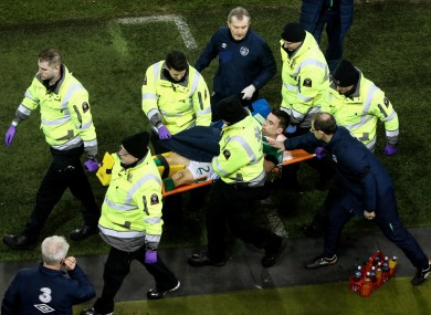 Ireland captain Seamus Coleman is comforted by manager Martin O'Neill while being stretchered off during Friday night's draw with Wales.