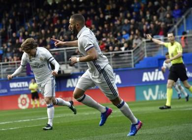 Real Madrid's Karim Benzema, center, celebrates scoring a goal, during the Spanish La Liga soccer match between Real Madrid and Eibar.