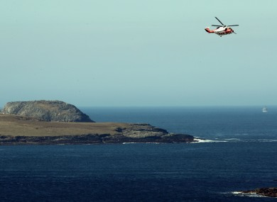 An Irish Coastguard helicopter searching along the coastline near Blacksod, Co Mayo during the week