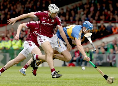 Galway's Daithi Burke and Tipperary's John McGrath battle for possession.