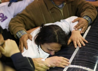 Relatives cry at funeral of victims in Tanta city