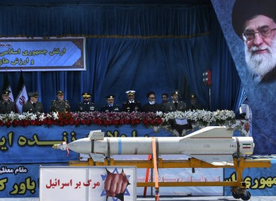 A missile is displayed on a truck with an anti-Israeli banner which reads in Persian