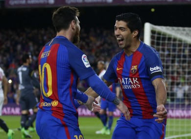 Lionel Messi (left) and Luis Suarez celebrate.