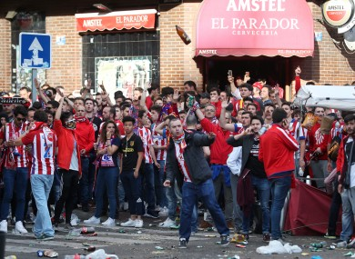 Police clash with Atletico Madrid fans outside the ground before the game.