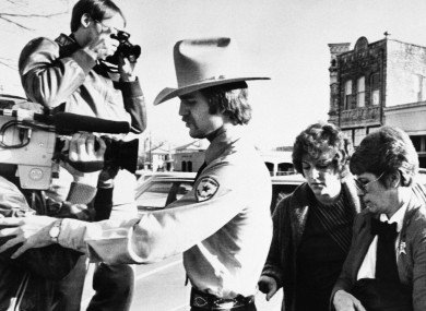 Genene Jones, second right, is escorted into Williamson County Courthouse in Georgetown, Texas in 1984.