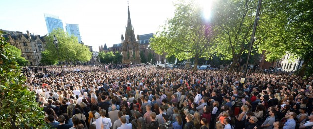 People gather for a vigil in Albert Square outside Manchester Town Hall in Manchester after a 23-year-old man was arrested in connection with the Manchester concert bomb attack.