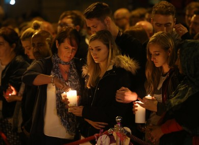 Mourners light candles and pause for a minute's silence in St Ann's Square, Manchester, as they mark the passing of exactly a week since the Manchester Arena terror attack.