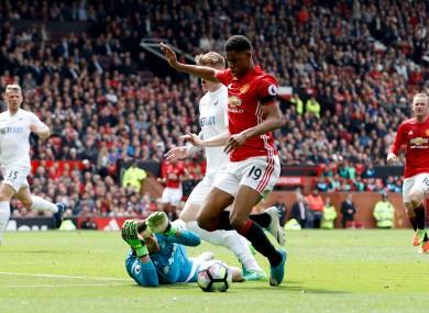 Manchester United's Marcus Rashford takes a tumble in the Swansea box.
