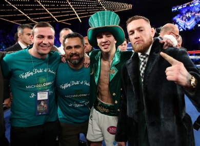 Michael Conlan celebrates with Matthew Macklin, Manny Robles and Conor McGregor after winning his professional debut on St Patrick's Day.