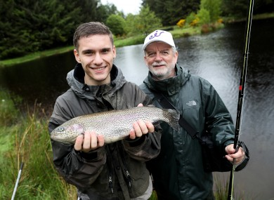Alex Popa and Ciaran Ward, Community Liaison, Eir, at Annamoe Trout Fishery in Wicklow.
