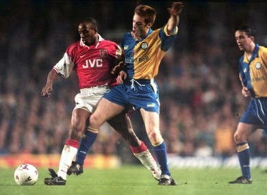 Maybury tackles Arsenal's Ian Wright during a Premiership clash in 1997.