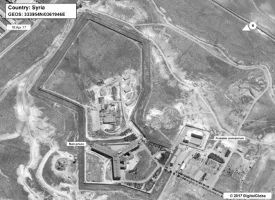 This image provided by the State Department and DigitalGlobe, taken April 18, 2017, a satellite image of what the State Department described as a building in a prison complex in Syria that was modified to support a crematorium.