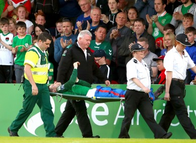 Dunleavy is carried off the pitch on Friday night.