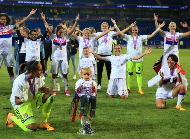 Lyon celebrate their Champions League win.