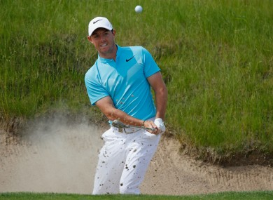 Rory McIlroy chips out of a bunker during the US Open.